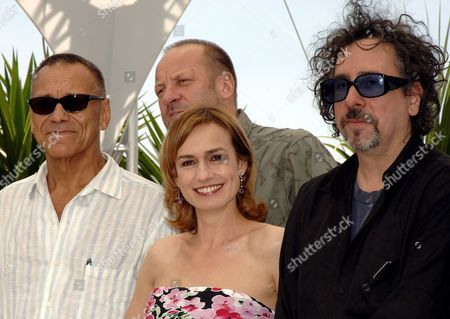 Stock Photo of President of the 'Jury Cinefondation' Russian Director Andrei Konchalovsky (l) Poses with Jury Members French Actress Sandrine Bonnaire (c-front) Polish Composer Zbigniew Preisner (c -back) and Us Director Tim Burton During a Photo Call of the Jury at the 59th Cannes Film Festival Thursday 25 May 2006 in Cannes