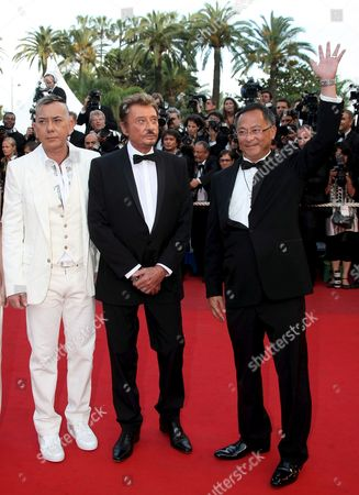Stock Picture of French Rockstar Johnny Hallyday (c) Actor Anthony Wong (l) and Director Johnny to (r) Arrive For the Gala Screening of Their Film 'Vengeance' by Johnny to Running in Competition During the 62nd Edition of the Cannes Film Festival in Cannes France 17 May 2009