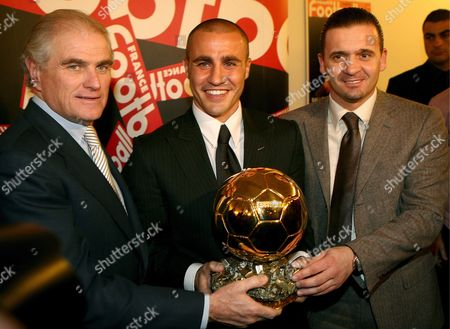 Embargo: No Usage Before 19:45 Cet On 27 November 2006! Italien Soccer Player Fabio Cannavaro (c) Poses with the President of Spanish Soccer Club Real Madrid Ramon Calderon (l) and Real's Sports Director Predrag Mijatovic During a Press Conference in Issy-les-moulineaux Close to Paris On Monday 27 November 2006 the 33-year Old Defender of Real Madrid and Captain of the Italien National Soccer Team Was Awarded by the French Soccer Magazine 'France Football' with the Ballon D'or (golden Football) As Best European Player of the Year
