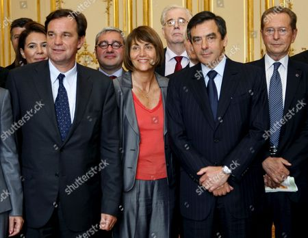 French Prime Minister Francois Fillon (2r) Poses with Culture Minister Christine Albanel (l) French Deputy Reanud Muselier (l) and President of the Arab Institute of Paris Dominique Baudis (r) at Matignon in Paris France 14 May 2009 to Present and to Launch the Cultural Council of Union For the Mediterranean the Union For the Mediterranean is a Community Initiated On 13 July 2008 by French President Nicolas Sarkozy As a Development of the Euromediterranean Partnership the Act Unites All Eu Members with Several Non-eu Countries That Border the Mediterranean Sea
