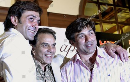 Bollywood Actors Sunny Deol (r) Bobby Deol (l) and Dharmendra (c) Pose During a Promotional Campaign For the Film 'Apne' in Calcutta India 25 June 2007