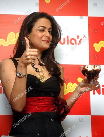 Stock Picture of Bollywood Actress Amrita Arora Reacts After Taste the Ice-cream During the Unveils of Newly Designed Quick Service Restaurant at Connaught Place in New Delhi India On 1 March 2007