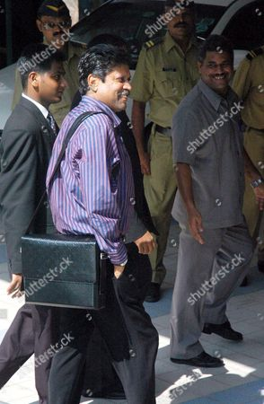 Stock Photo of Former Indian Cricket Captain Kapil Dev(2nd Left) Arrives to Attend a Meeting of the Board For Control of Cricket in India(bcci) in Bombay India On Friday April 06 2007 the Two-day Session Meeting with Former Indian Captains and the Present Captain Rahul Dravid Along with Coach Greg Chappell is On to Find Reasons For the World Cup Debacle of the Indian Cricket Team and Decide On a Future Roadmap Chappell 58 Had Earlier Resigned As India's Cricket Coach Following the Team's First-round Exit From the World Cup