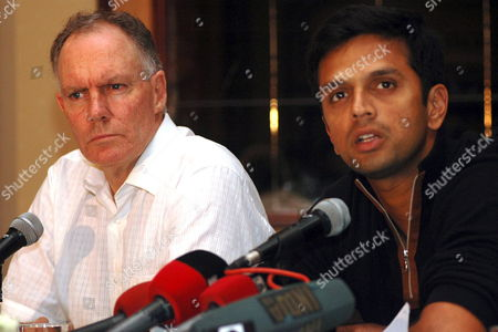 Indian Cricket Team Captain Rahul Dravid (r) Speaks As Coach Greg Chappell Looks On During a Press Conference in Bombay India On Monday 13 November 2006 Before Leaving For South Africa India Will Play Five One Day International Matches and Three Test Against South Africa the Series Will Start From 19 November 2006
