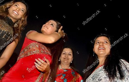 Dona Ganguly (r) Wife of Indian Skipper Sourav Ganguly Actress Tanushree Dutta (l) Celina Jetly (2ndl) Attend the Inauguration of Sourav Ganguly's Cricket Academy in Calcutta On Wednesday 05 October 2005 Woman 2nd R Unidentified