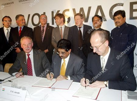 The Member of Board of Management of Volkswagen Ag Responsible For Finance Hans Dieter Potsch (r) the Secretary of Industries V K Jairath (c Sitting) and Chairman of Board of Management of Skoda Auto Detlef Wittig (l) During the Signing of the Agreement in New Delhi India On Wednesday 29 November 2006 German Automotive Group Volkswagen and the Western Indian State of Maharashtra Signed Wednesday an Investment Agreement For the Construction of a Vw Car Plant in What Was Termed the Biggest Single Investment in India Yet by a German Company Vw Put the Targeted Investment at 410 Million Euros (530 Million Dollars) For a Car Production Plant Near the City of Pune the Project Was Approved by Vws Supervisory Board Earlier This Month Vw Chief Financial Officer Hans Dieter Poetsch and the Head of the Companys Skoda Division Detlef Wittig Signed the Agreement Under Which Production is to Start Up in 2009 with the Plant to Produce 110 000 Cars Specially-designed For the India Market Annually