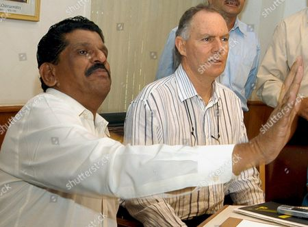 Secretary For the Board For Cricket Control in India (bcci) S K Nair Gestures While the Newly Appointed Indian Cricket Team Coach Greg Chappell (right) Looks On Tuesday 21 June 2005 at a Selection Committee Meeting Held Before Announcing the Indian Cricket Team Probables For the Forthcoming Sri Lankan Tour in Bangalore