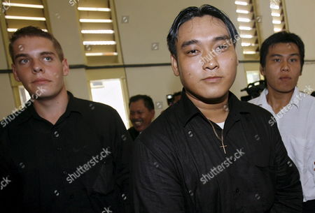 Australian Matthew Norman (l) Tan Duc Thanh Nguyen (c) and Si Yi Chen (r) Three of Six Australian Members of the 'Bali Nine' On Death Row Escorted by Court Officer After Their Judicial Review Trial at Denpasar District Court in Bali Indonesia On 09 May 2007 Lawyers Are Arguing That Indonesia's Supreme Court Was Wrong When It Upgraded Their Sentences From 20 Years' Jail to the Death Penalty