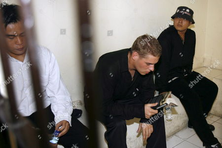 Australian Matthew Norman (c) Tan Duc Thanh Nguyen (r) and Si Yi Chen (l) Three of Six Australian Members of the 'Bali Nine' On Death Row Wait Inside a Holding Cell Before Their Judicial Review Trial at Denpasar District Court in Bali Indonesia On 02 May 2007 Lawyers Are Arguing That Indonesia's Supreme Court Was Wrong When It Upgraded Their Sentences From 20 Years' Jail to the Death Penalty