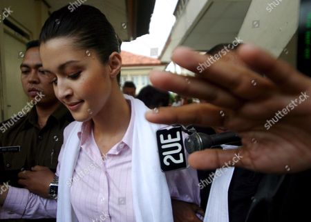 Australian Michelle Leslie Escorted by Court Officer Leaves a Courtroom After Her Trial at Denpasar District Court in Bali Indonesia On Tuesday 15 November 2005 Prosecutors Asked a Court to Sentence Leslie to Three Month Jail Leslie a Model Was Arrested in Bali After Police Said They Found the Party Drug Ecstasy in Her Bag