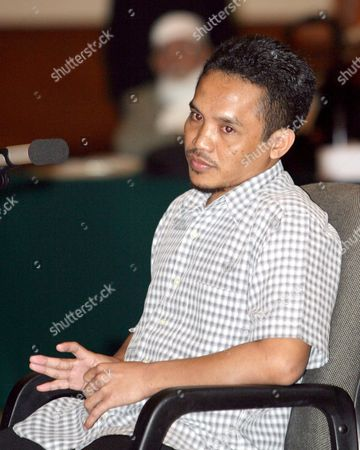One of the Core Bali Attackers - So-called Repentant Bomber Indonsesian Ali Imron As He Gives Testemony During a Trial of Muslim Cleric Abu Bakar Ba'asyir at a South Jakarta Court in Indonesia Thursday 20 January 2005 Ba'asyir is Currently On Trial For Allegedly Planning and Inciting His Followers to Carry out the Bali Bombings in 2002 That Killed Over 200 People Mostly Foreign Holidaymakers and the Attack On American Hotel Chain Jw Marriott in 2003 Which Killed 12 People Mostly Locals Later in the Trial a Former U S State Department Translator Said That 'A U S Presidential Envoy' Asked Megawati to Hand Over Ba'asyir to U S Authorities