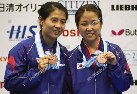 Bronze Medalists Kim Kyung Ah (l) and Park Mi Young (r) of South Korea Hold Up Their Medals On the Podium During the Awarding Ceremony For the Women's Doubles Tournament at the World Table Tennis Championship in Yokohama South of Tokyo Japan 04 May 2009