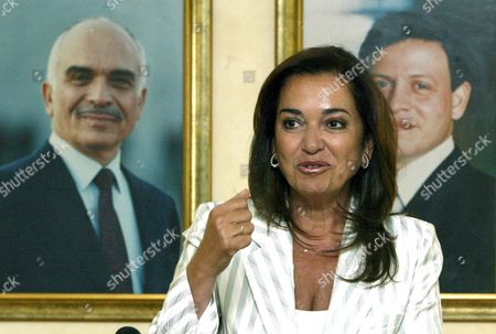 Greek Foreign Minister Dora Bakoyianni Speaks in Front of a Portrait of Jordanian King Abdullah (r) and Late King Hussein (l) During a Press Conference at Amman Airport Before Leaving Amman On Thursday 24 August 2006
