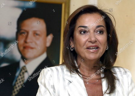 Greek Foreign Minister Dora Bakoyianni Speaks in Front of a Portrait of Jordanian King Abdullah During a Press Conference at Amman Airport Before Leaving Amman On Thursday 24 August 2006