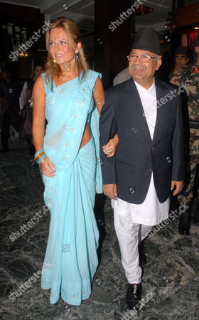 British Singer Geri Halliwell Walks with Nepal's Prime Minister Madhav Kumar Nepal at a Function Organized by the United Nations Population Fund (unfpa) in Kathmandu Nepal 09 September 2009 Halliwell a Goodwill Ambassador of the Unfpa is in Nepal For a Four Days Visit to Highlight the Consequences of Maternal Death and Injuries Such As Uterine Prolapsed in the Country