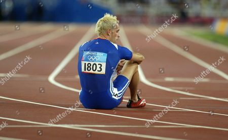 Matthew Elias From the British Relay Team Sits On the Track in Dejection After His Team's Fifth Place in the Men's 4x400m Relay Final in the Olympic Stadium at the Athens 2004 Olympic Games Saturday 28 August 2004 Epa Louisa Gouliamaki
