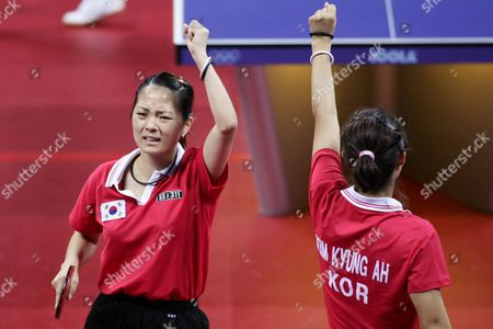 Kim Bok Rae (l) and Kim Kyung Ah (r) of Korea Celebrate As They Compete with Guo Yue and Niu Jianfeng of China During Their Bronze Medal Match of the Women's Doubles Table Tennis at the Athens Olympic Games Friday 20 August 2004 China's Wang Nan and Zhang Yining Won the Gold Medal Korea's Lee Sun Sil and Seok Eun Mi the Silver Guo Yue and Niu Jianfeng Won the Bronze Medal Epa Vasilis Ververidis