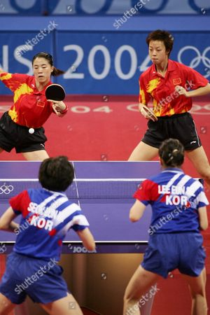 Chinese Wang Nan and Teammate Zhang Yining (rear) Compete with Lee Sun Sil and Seok Eun Mi (foregropund) of Korea During Their Women's Doubles Table Tennis Final at the Athens Olympic Games Friday 20 August 2004 Wang Nan and Zhang Yining Won the Gold Medal Lee Sun Sil and Seok Eun Mi Won Silver Guo Yue and Niu Jianfeng of China Won the Bronze Medal Epa Vasilis Ververidis
