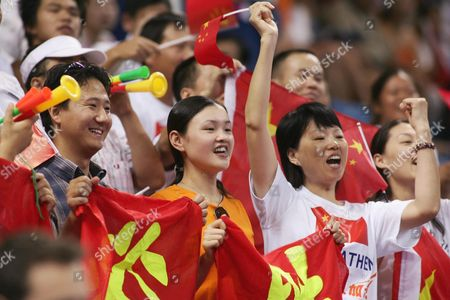 Chinese Supporters Celebrate in the Stands During the Women's Doubles Table Tennis Competition at the Athens Olympic Games Friday 20 August 2004 China's Wang Nan and Zhang Yining Won the Gold Medal Korea's Lee Sun Sil and Seok Eun Mi the Silver Guo Yue and Niu Jianfeng of China Won the Bronze Medal Epa Vasilis Ververidis