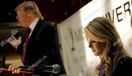 Stock Picture of Miss California Carrie Prejean (r) Listens to Us Entrepreneur Donald Trump (l) During a Press Conference where Trump Who Owns the Miss Usa Pageant Announced That Prejean Can Retain Her Title As Miss California in New York New York Usa On 12 May 2009 Prejean Failed to Reveal That She Had Posed in Her Underwear As a Teenager Before Last Month's Miss Usa Pageant