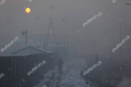A view of housing settlements shrouded in haze in the capital city of Ulaanbaatar, Mongolia, 12 January 2017. Mongolian President Tsakhiagiin Elbegdorj said on 11 January 2017, that air pollution in Ulaanbaatar has reached disaster levels and the city is declared to be in a state of disaster where measures like evacuations are recommended for some areas, according to local media.