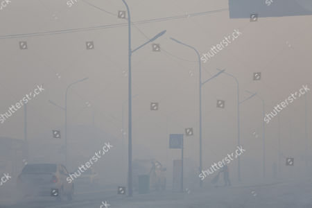 A view of a road shrouded in haze in the capital city of Ulaanbaatar, Mongolia, 12 January 2017. Mongolian President Tsakhiagiin Elbegdorj said on 11 January 2017, that air pollution in Ulaanbaatar has reached disaster levels and the city is declared to be in a state of disaster where measures like evacuations are recommended for some areas, according to local media.