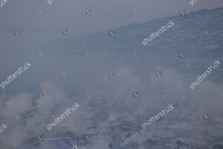 An aerial view of housing settlements shrouded in haze in the capital city of Ulaanbaatar, Mongolia, 12 January 2017. Mongolian President Tsakhiagiin Elbegdorj said on 11 January 2017, that air pollution in Ulaanbaatar has reached disaster levels and the city is declared to be in a state of disaster where measures like evacuations are recommended for some areas, according to local media.