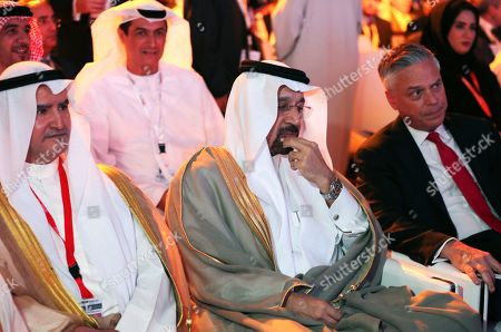 """Stock Image of Khalid al-Falih, Jon Meade Huntsman Jr Saudi Oil Minister Khalid al-Falih, middle, next to Jon Meade Huntsman Jr., Chairman of Atlantic Council, right, attend the opening ceremony of the Atlantic Council Global Energy Forum in Abu Dhabi, United Arab Emirates, . OPEC Secretary-General Mohammad Sanusi Barkindo said at the forum Thursday that he remains """"confident"""" that the cartel and outside members will stick to an agreement to cut production to help boost oil prices. The comments by Barkindo of Nigeria come as the cartel and nonmembers try to stick to the landmark deal after oil prices collapsed last year"""