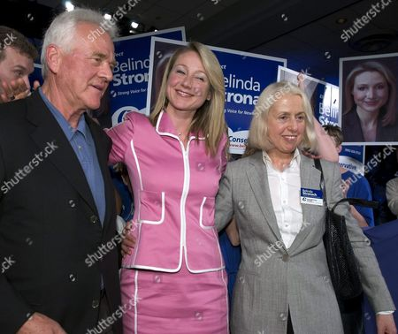 Conservative Candidate Belinda Stronach (c) Celebrates Her Win with Father Frank and Mother Alfreda in Canada's Federal Election Late Monday 28 June 2004 in Her Home Riding of Newmarket-aurora Stronach Former Ceo of Magna International Won by 625 Votes Stronach's Conservative Party Finished Second Overall with the Liberal Party Being Returned to Power with a Minority Government