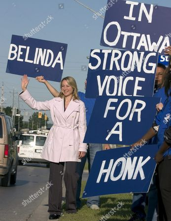 Conservative Candidate Belinda Stronach the Former Ceo of Magna International Greets the Early Morning Traffic Rush in Newmarket Canada 25 June 2004 Canadians Vote For a New Federal Government 28 June Stronach is Expected to Win in Her Riding of Newmarket-aurora Which is About 45 Km North of Toronto
