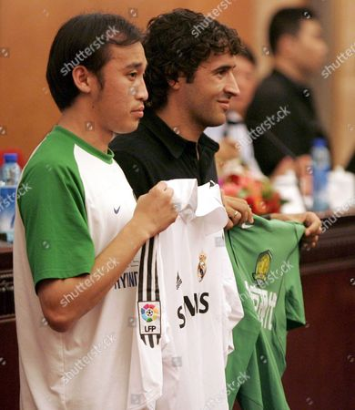 Real Madrid's Captain Raul Gonzales (r) and Beijing Guo An's Captain Tao Wei Exchange Shirts During a Press Conference Held at the Great Hall of the People in Beijing China Thursday 21 July 2005