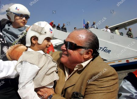 Dr Nasr Abel Al (r) with Mohamed Ibrahim (c) and Ahmed Ibrahim (l) Upon Their Arrival at Cairo International Airport Sunday 20 November 2005 the Former Conjoined Twins Were Arriving Home to Egypt After Receiving Extensive Surgery to Separate Them in the United States