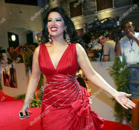 Egyptian Actress Somya Al-khashab Waves to the Crowd During the Premiere of the New Movie 'Omaret Yakoubian' ('yacoubian Building') On Monday 19 June 2006 the Best-selling Book by Author Alaa Al Aswany Follows the Lives of Residents Both Rich and Poor of an Actual Apartment Building in Downtown Cairo the Star-studded Movie Cast and Reported 22 Million Egyptian Pounds (4 Million Usd - 3 2 Million Euros) Budget Deals with Controversial Uncomfortable and Often Taboo Subjects About the Secular World of a Modern Islamic Country the Movie Will Be Screen in Theaters From Wednesday 21 June 2006