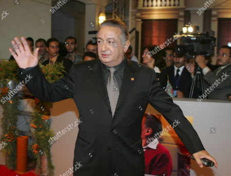 Egyptian Actor Nour Al-shreif Waves to the Crowd During the Premiere of the New Movie 'Omaret Yakoubian' ('yacoubian Building') On Monday 19 June 2006 the Best-selling Book by Author Alaa Al Aswany Follows the Lives of Residents Both Rich and Poor of an Actual Apartment Building in Downtown Cairo the Star-studded Movie Cast and Reported 22 Million Egyptian Pounds (4 Million Usd - 3 2 Million Euros) Budget Deals with Controversial Uncomfortable and Often Taboo Subjects About the Secular World of a Modern Islamic Country the Movie Will Be Screen in Theaters From Wednesday 21 June 2006