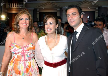 Egyptian Actress Yosra (l) Tunisian Actress Hend Sabri (c) and Actor Mohamed Emam (r) Pose For Photographers During the Premiere of the New Movie 'Omaret Yakoubian' ('yacoubian Building') On Monday 19 June 2006 the Best-selling Book by Author Alaa Al Aswany Follows the Lives of Residents Both Rich and Poor of an Actual Apartment Building in Downtown Cairo the Star-studded Movie Cast and Reported 22 Million Egyptian Pounds (4 Million Usd - 3 2 Million Euros) Budget Deals with Controversial Uncomfortable and Often Taboo Subjects About the Secular World of a Modern Islamic Country the Movie Will Be Screen in Theaters From Wednesday 21 June 2006