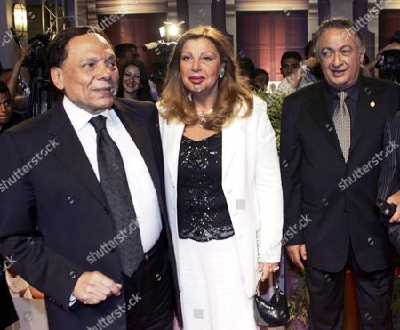 Egyptian Actor and Unhcr Goodwill Ambassador Adel Imam (l) His Wife (c) and Egyptian Actor Nour Al-shreif Pose For Photographers During the Premiere of the New Movie 'Omaret Yakoubian' ('yacoubian Building') On Monday 19 June 2006 the Best-selling Book by Author Alaa Al Aswany Follows the Lives of Residents Both Rich and Poor of an Actual Apartment Building in Downtown Cairo the Star-studded Movie Cast and Reported 22 Million Egyptian Pounds (4 Million Usd - 3 2 Million Euros) Budget Deals with Controversial Uncomfortable and Often Taboo Subjects About the Secular World of a Modern Islamic Country the Movie Will Be Screened in Theaters From Wednesday 21 June 2006