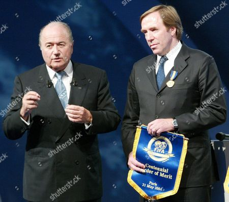 Fifa President Joseph Blatter (l) Gestures After Awarding German Soccer Legend Guenther Netzer with the Centennial Order of Merit During the 1st Day of the Fifa Centennial Congress in Paris Thursday 20 May 2004 Fifa Holds Its 54th Congress at the Carrousel Du Louvre in Paris Just a Stone's Throw Away From '229 Rue Saint-honor?' where Fifa Was Founded On 21 May 1904 by Representatives of Seven Nations; Spain Denmark Switzerland Sweden Belgium Netherlands and France