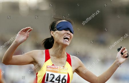 China's Wu Chun Miao Celebrates After Winning the 200m T11 (blind) Women Final For the Athens 2004 Paralympic Games Friday 24 September 2004