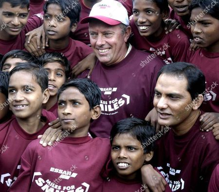Former Indian Cricketer Mohammed Azhurudin (r in Center Line) with Athlete Steve Ovett (c) with Children During a Press Conference in Bombay Maharashtra On Friday 14 January 2005 Regarding the Standard Chartered Mumbai Marathon 2005 Which is Scheduled On January 16 2005 in Bombay India