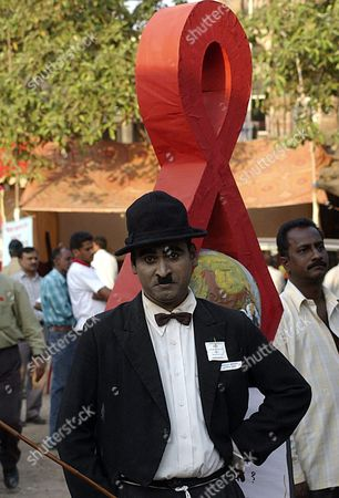 An Indian Man Dressed As Charly Chaplin During a Campaign in Bombay India On the Occasion of the World's Aids Day On 01 December 2004 the Fight Against the Hiv/ Aids Disease is Focused Currently On the Female Population Due to More Than the Middle of Above 40 Million World-wide People Infected with the Hiv/ Aids Are Women