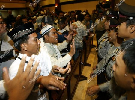 Supporters of Indonesian Muslim Cleric Abu Bakar Ba'asyir Angrily Shout During His Trial at South Jakarta's Court in Indonesia 21 December 2004 a Key Witness in the Trial of Indonesian Cleric Abu Bakar Bashir Told a Court Today That the Ageing Firebrand Preacher Was Head of Jemaah Islamiah a Militant Group Seen As the Southeast Asian Arm of Al Qaeda the Witness Nasir Abbas a Malaysian Who Claims to Have Been a Jemaah Islamiah Instructor at a Camp in the Southern Philippines Said Bashir Visited the Camp in April 2000 and Spoke at a Graduation Ceremony For Recruits