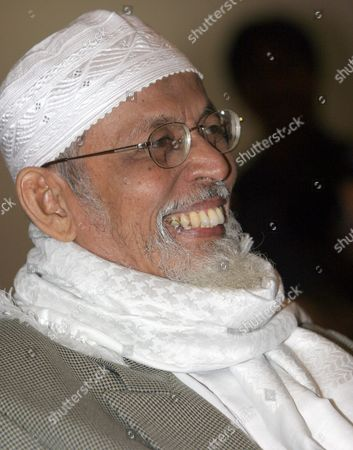 Indonesian Muslim Cleric Abu Bakar Ba'asyir Smiles As He Listens to One of the Core Bali Attackers - So-called Repentant Bomber- Indonsesian Ali Imron As He Gives Testemony During a Trial of Muslim Cleric Abu Bakar Ba'asyir at a South Jakarta Court in Indonesia Thursday 20 January 2005 Ba'asyir is Currently On Trial For Allegedly Planning and Inciting His Followers to Carry out the Bali Bombings in 2002 That Killed Over 200 People Mostly Foreign Holidaymakers and the Attack On American Hotel Chain Jw Marriott in 2003 Which Killed 12 People Mostly Locals Later in the Trial a Former U S State Department Translator Said That 'A U S Presidential Envoy' Asked Megawati to Hand Over Ba'asyir to U S Authorities