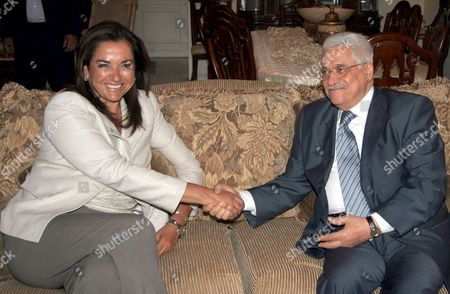 Greece's Foreign Minister Dora Bakoyianni (l) Shakes Hands with Palestinian President Mahmoud Abbas During Their Meeting in Amman Wednesday 23 August 2006
