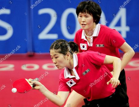 Kim Korean Players Eun Sil Lee (l) and Teammate Eun Mi Seok (back) in Action Against Compatriotes Bok Rae Kim and Kyung Ah Kim in Semi-final Action in the Women's Doubles Table Tennis Semi-final at the Galatsi Olympic Hall in Athens Thursday 19 August 2004 Lee and Seok Won 4-0 and Will Meet China in the Final Epa/dpa/ansa/filippo Monteforte Greece Athens