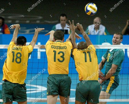 Brazilian Defenders (from Left) Dante Amaral Gustavo Endres and Anderson Rodrigues Leap to Stop a the Smash From Australia's David Beard (r) During a Men's Preliminary Volleyball Match of the Athens 2004 Olympic Games Sunday 15 August 2004 Brazil Won 3-1 Epa Kim Ludbrook