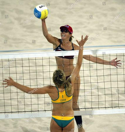 Elaine Youngs From the Usa (above) Hits a Smash While Natalie Cook From Australia Tries to Defend While Playing the Women's Beach Volleyball Bronze Medal Match with Her Teammate Holly Mcpeak Against Canada's Natalie Cook (c) and Nicole Sanderson (r) at the Olympic Beach Volleyball Centre in Athens Tuesday 24 August 2004 the United States Defeated Australia 2-1 to Win the Bronze Medal Epa/dpa/kim Ludbrook