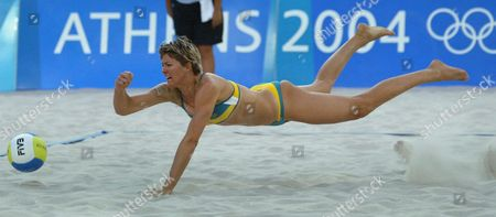 Canada's Natalie Cook Dives For the Ball While Playing the Women's Beach Volleyball Bronze Medal Match with Her Teammate Nicole Sanderson Against Holly Mcpeak and Elaine Youngs From the Usa at the Olympic Beach Volleyball Centre in Athens Tuesday 24 August 2004 Epa/dpa/kim Ludbrook