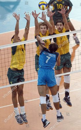 Brazilian Players (from Left Yellow Shirts) Andre Nascimneto Andre Heller and Gilberto Godoy Filho Try to Block a Shot by Italian Andrea Sartoretti During the Final of the Athens 2004 Olympic Games Men's Volleyball Final at the Peace & Friendship Stadium in Athens Sunday 29 August 2004