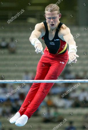 Germany?s Fabian Hamb?chen Performs On the Horizontal Bar in the Olympic Indoor Hall During the Men?s Team Final in Gymnastics at the Athens 2004 Olympic Games 16 August 2004 Epa/dpa Louisa Gouliamaki