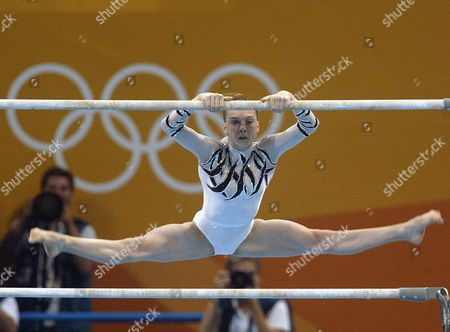 Elena Gomez of Spain Performs During the Women's Qualification Round On the Asymetric Bars As Part of the Gymnastics at the Athens 2004 Olympic Games at the Hellinikon Indoor Arena Sunday 15 August 2004 Epa Louisa Gouliamaki